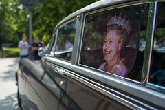 Photo of the queen in vintage car. Photo of the queen in british vintage car Royalty Free Stock Image