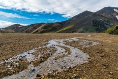 View of Rainbow Mountains Landmannalaugar. Photo of Rainbow mountains Landmannalaugar and the river flowing through the valley Royalty Free Stock Images