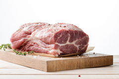 Photo of raw meat. Pork neck with herbs Stock Photography