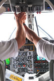 Photo rear view of pilot and copilot in airplane. Cockpit Royalty Free Stock Image