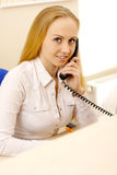 Photo of reception worker. Royalty Free Stock Photography
