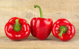 Photo of red bell peppers on wooden table Royalty Free Stock Photos