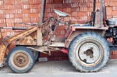 Bricks and bulldozer Stock Photos