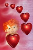 Photo of Red Floating Hearts and Little Cupid Doll with Green. Eyes - Love. Symbols of Love and Romance royalty free illustration
