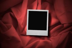 Photo on red satin Royalty Free Stock Image
