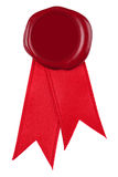 Photo of a red wax seal and ribbon. Royalty Free Stock Photo