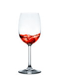 Red wine pouring into wine glass isolated on white background Stock Image