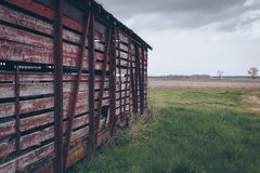 Photo of Red Wooden Shed on Green Grass Field Royalty Free Stock Image
