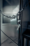 Photo of refrigerator locked by chain and metal lock Stock Images
