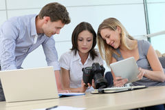 Photo reporters using digital devices Royalty Free Stock Photography