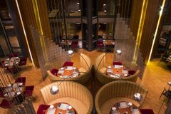 Photo of the restaurant when there are no guests yet. Luxurious restaurant, nice interior. Armchairs and sofas at the served stock photo