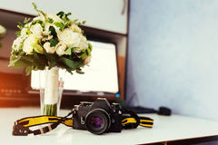 Photo retro camera on a table with different objects Stock Photography