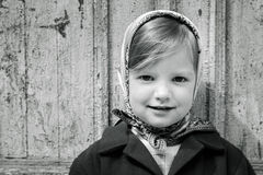 Photo in retro style. Cute little girl in a kerchief. Stock Image
