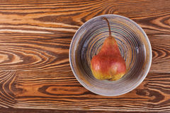 Photo ripe fresh pear on wood desk. Stock Image