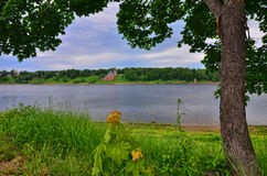 A photo of a river and a church in the background Russian Federation Stock Photography