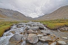 Photo of River Filled With Bolder Rocks Stock Photo