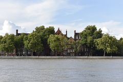 Thames river and some houses. A photo of the river Thames, boats and houses. Trees and skies. Amazing wallpaper Royalty Free Stock Photo