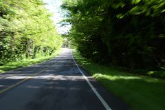 Photo of the road with a blur effect and in motion.  stock photography