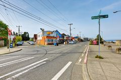 Photo of a road with a road sign at Alki beach park Royalty Free Stock Images