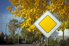 Photo of a road sign. The photo of a road sign on an autumn background Royalty Free Stock Photography