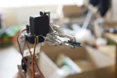Photo of robot manipulator, which holds the chip stock photo