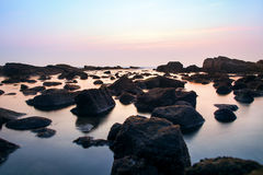 Photo of rocks in the sea. Royalty Free Stock Images