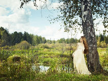 Photo of romantic woman in fairy forest. Beauty autumn Royalty Free Stock Image