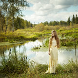 Photo of romantic woman in fairy forest. Beauty autumn Stock Photography