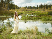 Photo of romantic woman in fairy forest. Beauty autumn Royalty Free Stock Photo