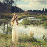 Photo of romantic woman in fairy forest. Beauty autumn stock image