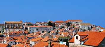 The churches seen from above. Photo of the roofs, buildings and churches of Dubrovnik city in the morning  - Croatia - July 2010 Stock Photography