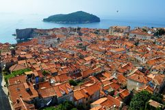 The roofs and the island. Photo of the roofs, buildings and fortification of Dubrovnik city in the morning  - Croatia - July 2010 Royalty Free Stock Photography