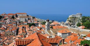 The roofs and the city wall. Photo of the roofs, buildings and fortification of Dubrovnik city in the morning  - Croatia - July 2010 Royalty Free Stock Photos