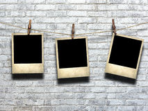Photo on rope with clothespins on a background of a brick wall Stock Photography