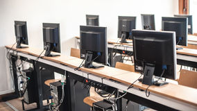 Photo of row computers in classroom or other educational institution. Close up stock photos