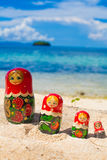 Photo Rows Puzzle Russian Dolls Matrioshka Souvenir Untouched Tropical Beach in Bali Island. Vertical Picture. Blurred Stock Photo