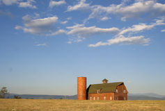 Photo of rural red barn with blue sky Stock Images