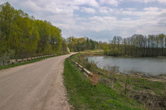 Photo of rural road with lake. Photo of rural road with lake in the midday Stock Photos