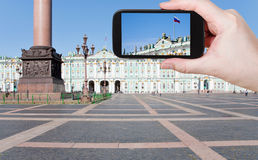 Photo of Russian state flag on Palace Square. Travel concept - tourist shooting photo of Russian state flag on Palace Square, St.Petersburg, Russia on mobile stock image