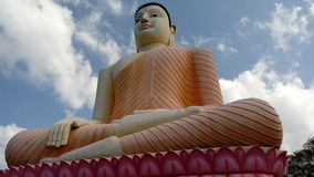A photo of sacred statue of lord Buddha situated at Kande Viharaya Sri Lanka royalty free stock photography