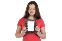 Photo of sad teenage girl with photo frame. On white background Stock Photography