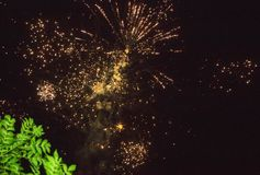 A photo of a salute in the night sky. Bright texture of festive fireworks. Abstract holiday background with various colors firewor Stock Photography