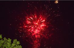 A photo of a salute in the night sky. Bright texture of festive fireworks. Abstract holiday background with various colors firewor Stock Images