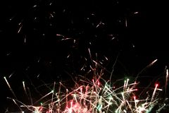 A photo of a salute in the night sky. Bright texture of festive fireworks. Abstract holiday background with various colors Royalty Free Stock Image