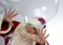 Photo of Santa with big soap bubble Royalty Free Stock Photography
