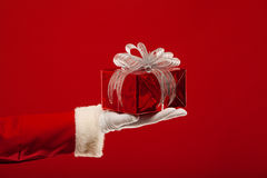 Photo of Santa Claus gloved hand with  giftbox, on Royalty Free Stock Photography