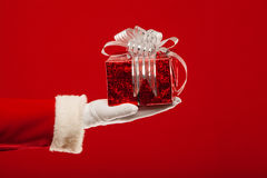 Photo of Santa Claus gloved hand with  giftbox, on Royalty Free Stock Photos