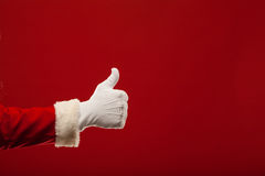 Photo of Santa Claus gloved hand in pointing. Gesture. fingers Royalty Free Stock Photography