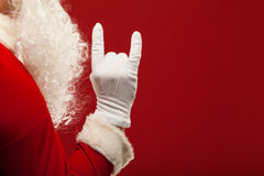 Photo of Santa Claus gloved hand in pointing Royalty Free Stock Photos