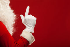 Photo of Santa Claus gloved hand in pointing Stock Photography